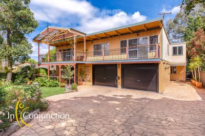 large family home with extended accommodation suitable for in-laws or additional family members.