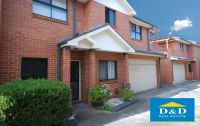 immaculate 3 bedroom townhouse. private sunny courtyard. 3 toilets. double garage. walk to parramatta city centre.