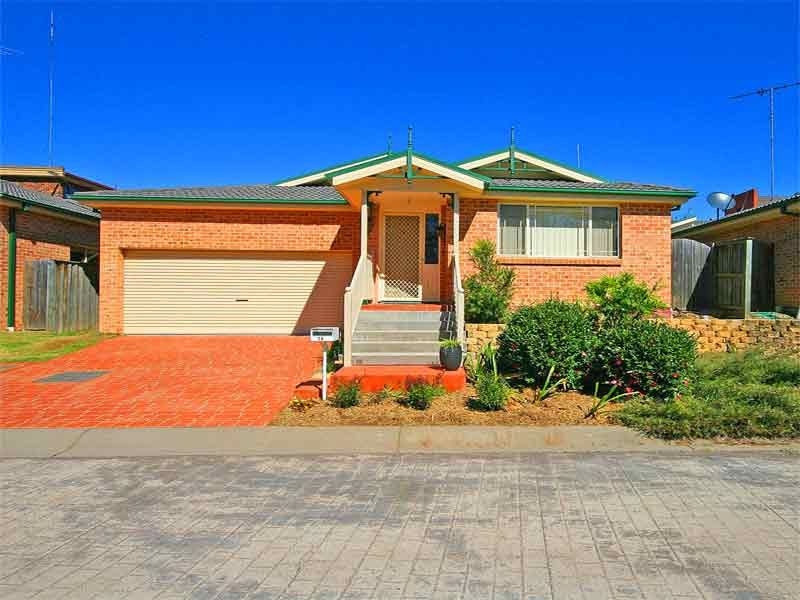 Attention First Home Buyers!! Gorgeous deceptively spacious single level brick 3 bedroom 2 bathroom home on pretty low maintenance block.