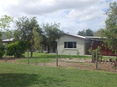 ENJOY THE TRANQUIL LIFESTYLE IN THIS BEAUTIFUL ACREAGE HOME