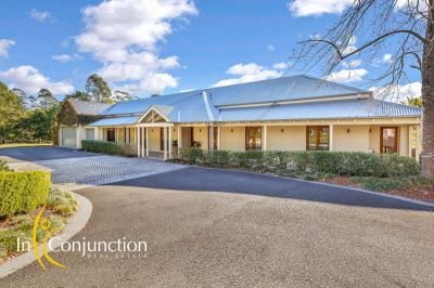 relaxed architectural luxury on beautiful acreage with resort-style facilities. ideal for large families/in-laws.