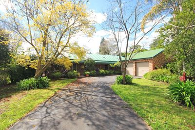 as pretty as a picture  picturesque single level home surrounded by cottage gardens in lovely rural setting.