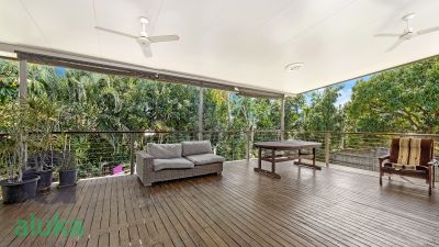 Relax on the massive deck overlooking the beautiful gardens
