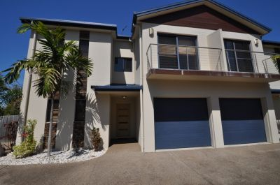 Ideally located townhouse with huge private courtyard, perfect for entertaining and relaxed living.
