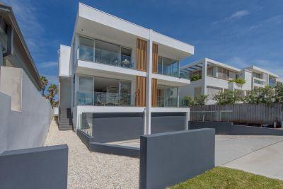 Luxury New Masterpiece With Ocean Views & Pool in Elite Coastal Enclave