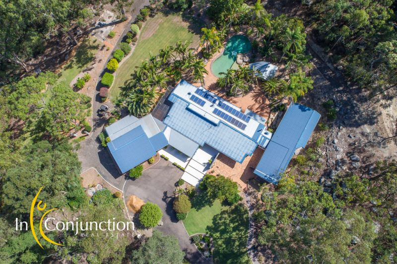 Stunning executive home in relaxed private resort- like setting with beautiful pool and large shed.