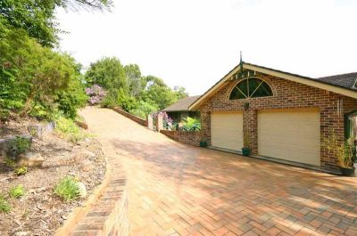 a magic hideaway: totally tranquil and private setting with outstanding views. impressive 5 bedroom double brick home on just under an acre