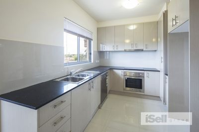 Centrally located, top level apartment