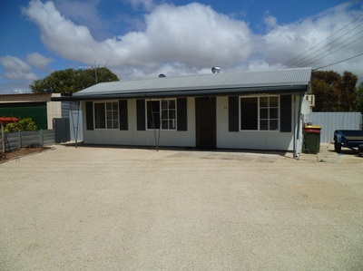 NEAT FURNISHED THREE BEDROOM HOME ON LARGE CORNER BLOCK CLOSE TO BEACH