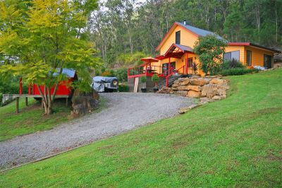 enchanting 5 bedroom family home; picture-book setting on just over an acre with gorgeous river views, just minutes to wisemans ferry.