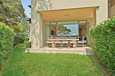 Spacious bay view garden apartment