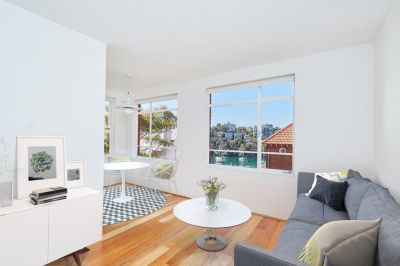 BOUTIQUE ONE BEDROOM + STUDY WITH WATER VIEWS