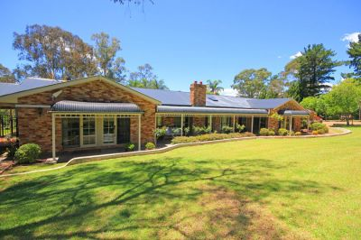 charming colonial style country home on private acres with resort style pool + in-law wing. ideal for extended families.
