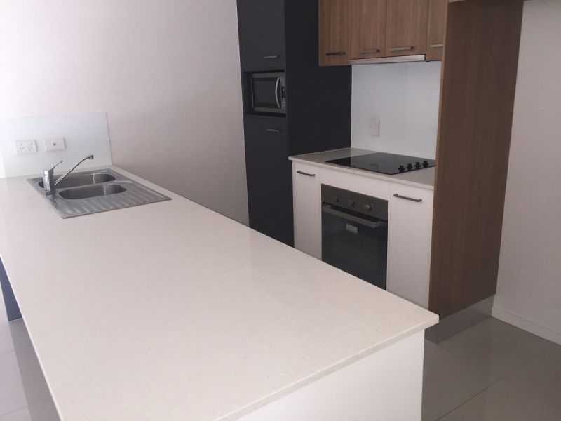 GROUND FLOOR TWO BEDROOM UNIT WITH ENSUITES -AND SEPARATE STUDY