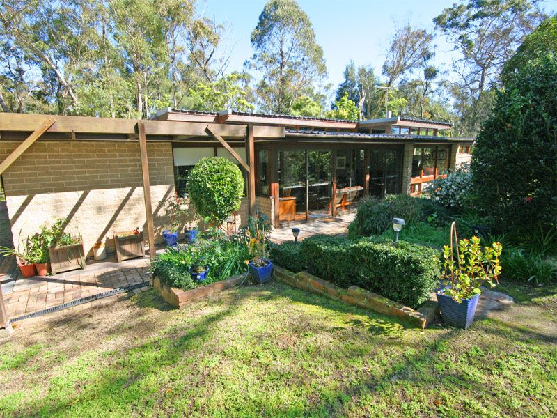 OPEN HOME CANCELLED. UNDER CONTRACT. Beautiful retreat-like property with gorgeous established gardens and wide open horse paddocks.