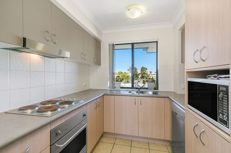 Beautifully presented apartment in boutique garden complex