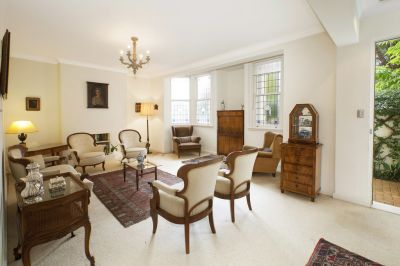 Delightful House-Size Garden Apartment in Prestigious Landmark Building