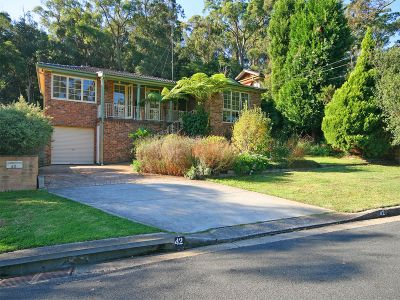 beautifully presented 4 bedroom bright modern, family home with beautiful bush land backdrop. independent s/c office, good for home business.