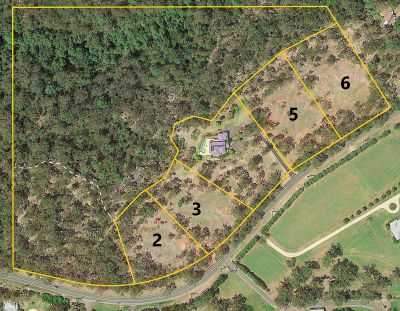 gorgeous vacant block of just under 2 acres with northerly views to the rear overlooking nature reserve.