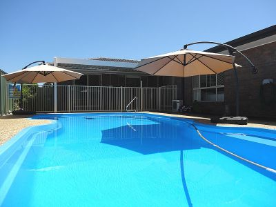 IMMACULATE HOME WITH POOL IN A QUIET LOCATION