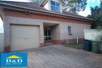 Delightfully Renovated 3 Bedroom Townhouse. 2 Bathrooms. 2 Car Lock Up Garage. Quiet Location.
