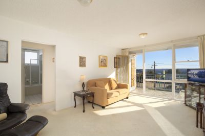 North Facing Apartment with Water Views and Scope to Renovate