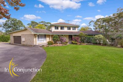 highly sought-after smaller acres with impressive 5 bedroom home in quiet location.