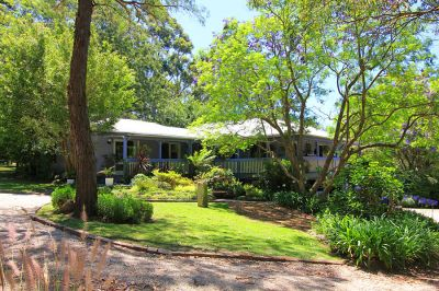 picturesque country cottage surrounded by beautiful cottage gardens on attractive 5 acres.