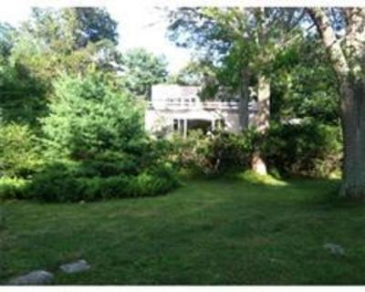 Rustic Frank Lloyd Wright style home on a lovely 8 acre lot surrounded by conservation land.