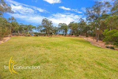 immaculately presented 4 bedroom single level home with large shed, in-ground pool and magical views.