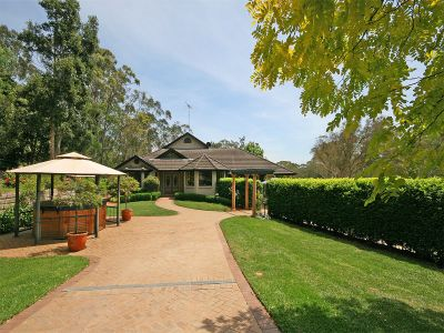 sold by in conjunction real estate. elegant home with stunning formal gardens, privately positioned at the end of a long driveway.