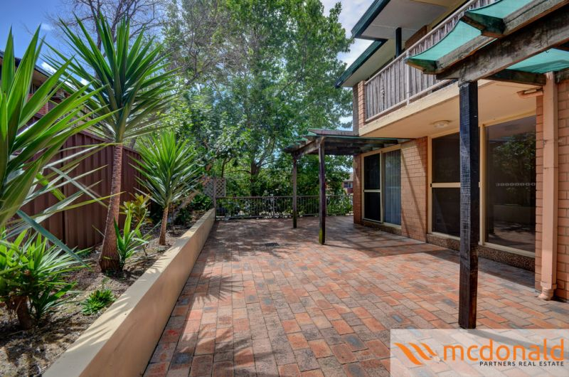 Two bedroom unit with pool and tennis court in complex