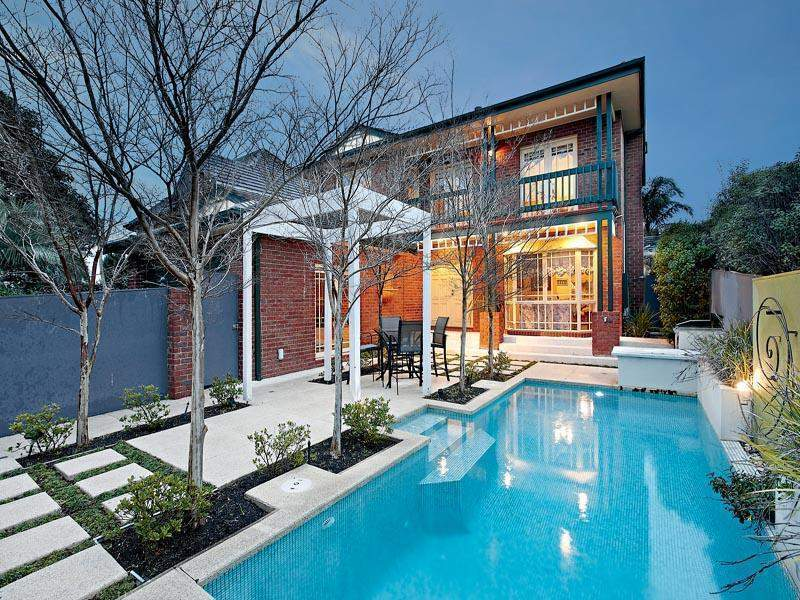 LOW MAINTENANCE POOLSIDE LIFESTYLE PROVIDES TEENAGE SPACE AND PARENTAL PEACE