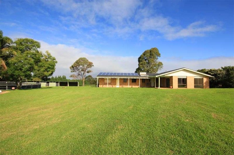 Private, elevated pretty single level home on the most stunning north facing block with commanding views