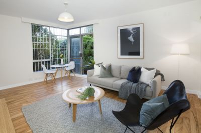Tranquil Apartment Opens to Garden Area with Secure Parking
