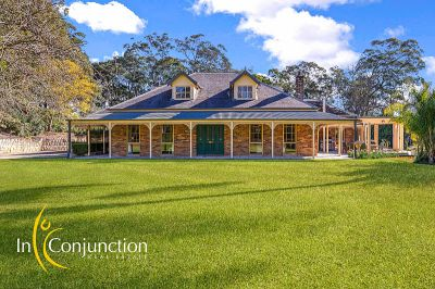 southern highlands comes to dural. bowral-style country residence in secluded location with breathtaking views over lake-like dam and stunning acres.