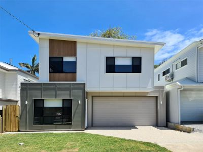 Brand new and a stone's throw from the beach