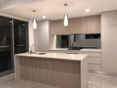 Apartment with Style, Comfort & Convenience - Finished with Caesar Stone Kitchen. Close to Train, Buses, Shops and Restaurants