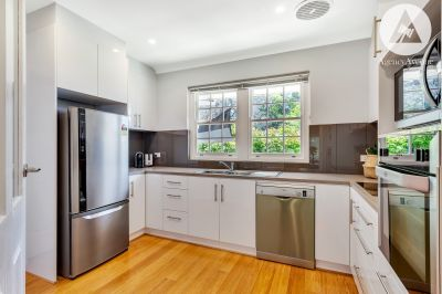 IMMACULATELY RENOVATED UNIT IN A PRIVATE & QUIET SETTING