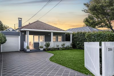 Solid brick family home with a granny flat and pool, perched on 600+ sqm with unbeatable potential just moments walk to Majors Bay