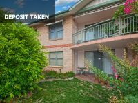 DEPOSIT TAKEN - Spacious unit with a sunny north-easterly facing orientation