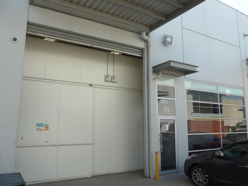 6.4% YIELD. WAREHOUSE SHELL WITH 2 CAR PARKS