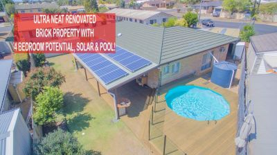 ULTRA NEAT, RENOVATED BRICK HOME WITH 2 LIVING AREAS, POOL & SOLAR!