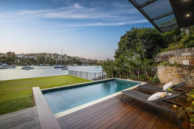 Absolute waterfront home of refined modern elegance.