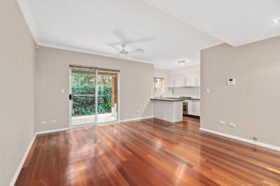 Modern two bedroom townhouse with double garage plus storage