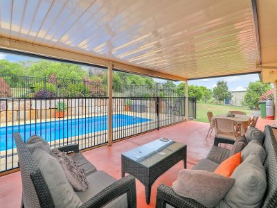 Acreage at end of quite cul de sac with solar heated pool