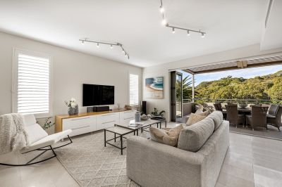 Understated elegance moments to iconic Balmoral Beach.