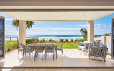 PICTURE PERFECT VIEWS FROM THREE-LEVEL RESIDENCE ON ABSOLUTE BEACHFRONT
