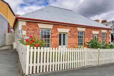 Stunning fully furnished convict brick cottage in a highly sought location
