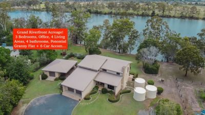 PRIVATE RIVER FRONT ESTATE WITH LARGE HOME AND SHEDS WITH DUAL LIVING OPTIONS!